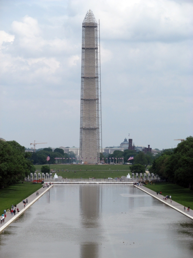 Washington Memorial in scaffolding. It kind of looks Saran-wrapped to me.
