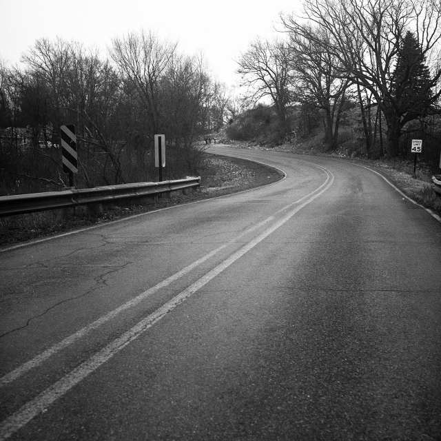 Black and white photo of a road